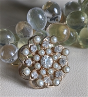 Round gold tone brooch multiple clear stones great