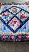 Raggedy Ann and Andy heart border quilted blanket
