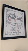 Needlepoint frame work with carriage and phrase