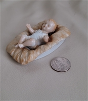 Vintage porcelain Baby Jesus figurine made in Japan Nativity collectible.