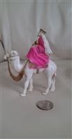 Vintage celluloid plastic merchant on a camel