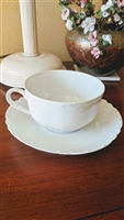 Haviland France white embossed teacup and saucer