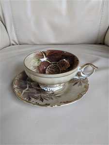 Porcelain teacup and saucer PineCones decor theme