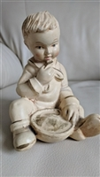 Coventry chalkware sitting boy figurine 1940