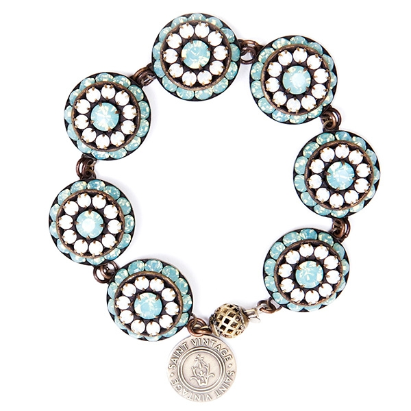 "Beautiful aquamarine and white crystals are featured in this pretty bracelet with tons of sparkle. 7""in length."