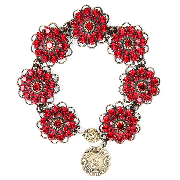 "Ruby crystal charms are featured in this pretty handmade bracelet perfect for any season. 7""in length."