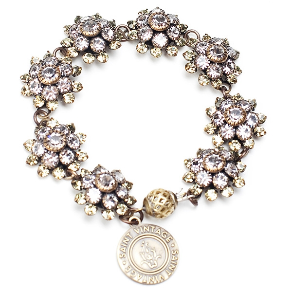 "Our pretty pastel yellow and clear crystal bracelet sparkles during an season. 7""in length."