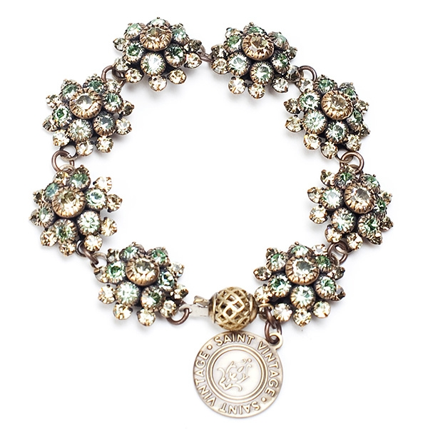 "Our pretty green and almond crystal bracelet sparkles during an season. 7""in length."