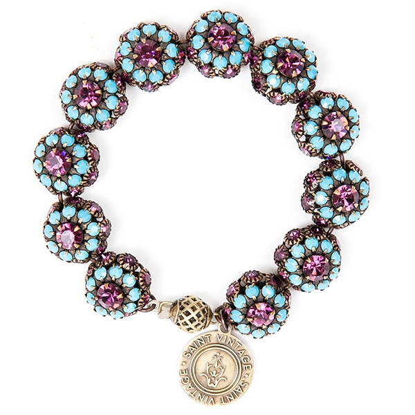 "Beautiful amethyst and turquoise crystals are featured in this pretty bracelet with tons of sparkle. 7""in length."