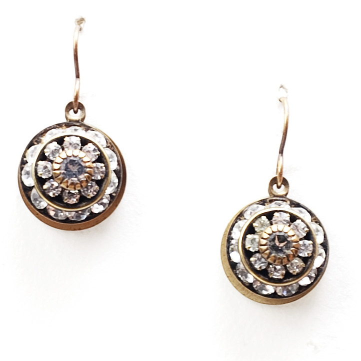 "Beautiful petite clear crystal Love Drop earrings that are sure to get noticed. 1.25"" drop."