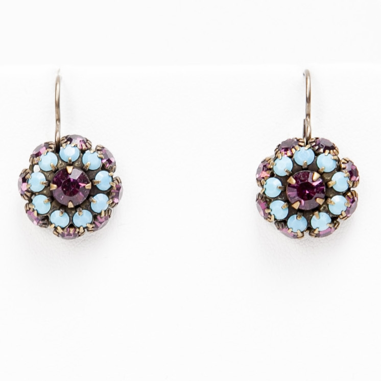 "A beautiful color combination of amethyst and turquoise create these bright Love Drop earrings that are sure to sparkle at any event. 1.25"" drop."