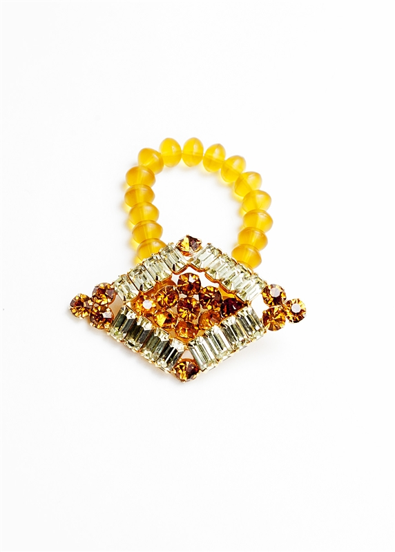 An one of a kind antique topaz and clear crystal brooch is paired with soft yellow beads to create a truly stunning piece of jewelry from our Wear a Bracelet, Find a Cure Campaign.
