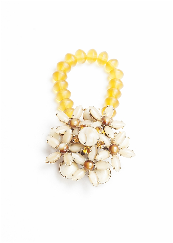 An one of a kind antique ivory floral brooch is used with soft yellow beads to create a truly stunning piece of jewelry from our Wear a Bracelet, Find a Cure Campaign.
