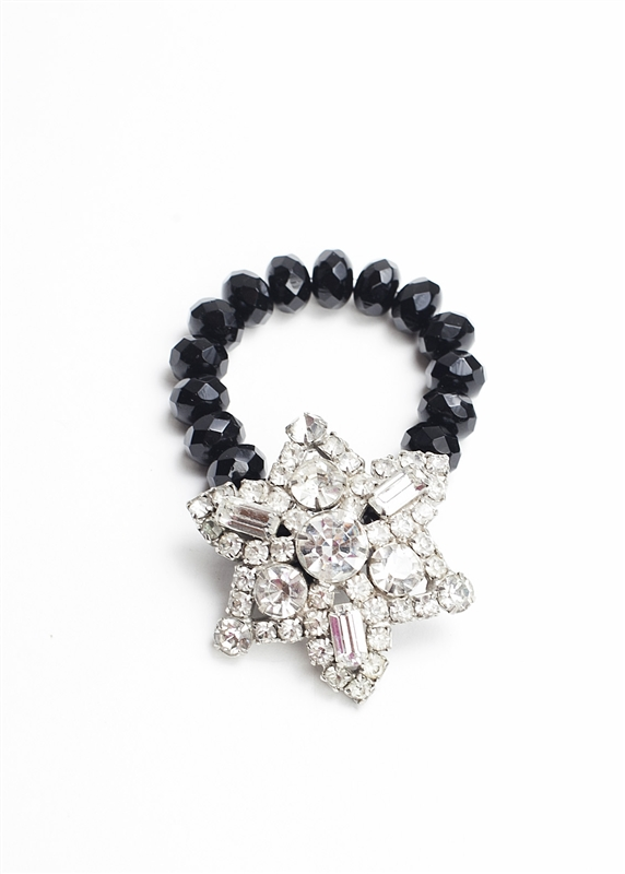 An antique white crystal brooch created into a one of a kind stretch bracelet using vintage jet beads. A truly stunning piece of arm candy from our Wear a Bracelet, Find a Cure Campaign.