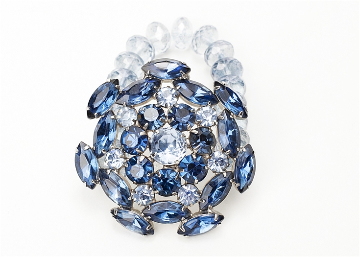 Antique sapphire crystal brooch created into a one of a kind stretch bracelet using ice blue vintage beads.  A truly stunning piece of arm candy from our Wear a Bracelet, Find a Cure Campaign.