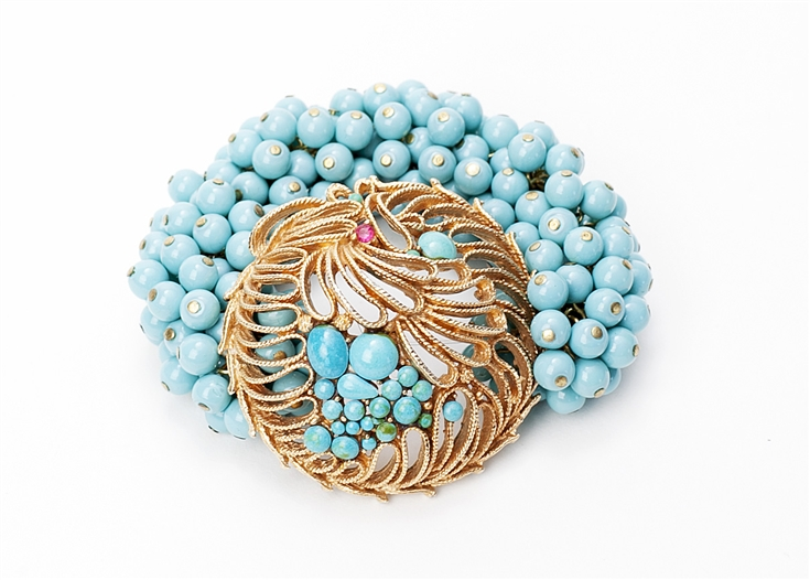 Antique turquoised and gold crystal brooch created into a one of a kind stretch bracelet using vintage turquoise beads. A truly stunning piece of arm candy from our Wear a Braclet, Find a Cure Campaign.