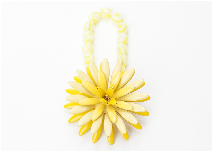 An one of a kind antique bright yellow floral brooch is paired with soft yellow antique beads to create a truly stunning piece of jewelry from our Wear a Bracelet, Find a Cure Campaign.