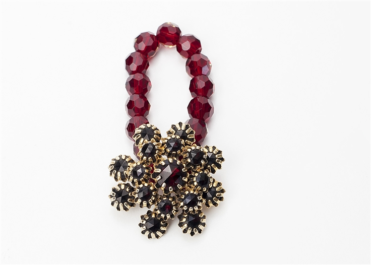 An one of a kind antique garnet crystal floral brooch is used with garnet crystal beads to create a truly stunning piece of jewelry from our Wear a Bracelet, Find a Cure Campaign.