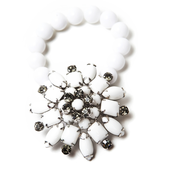 An antique white and black diamond floral brooch created into a one of a kind stretch bracelet using vintage beads. A truly stunning piece of arm candy from our Wear a Bracelet, Find a Cure Campaign.