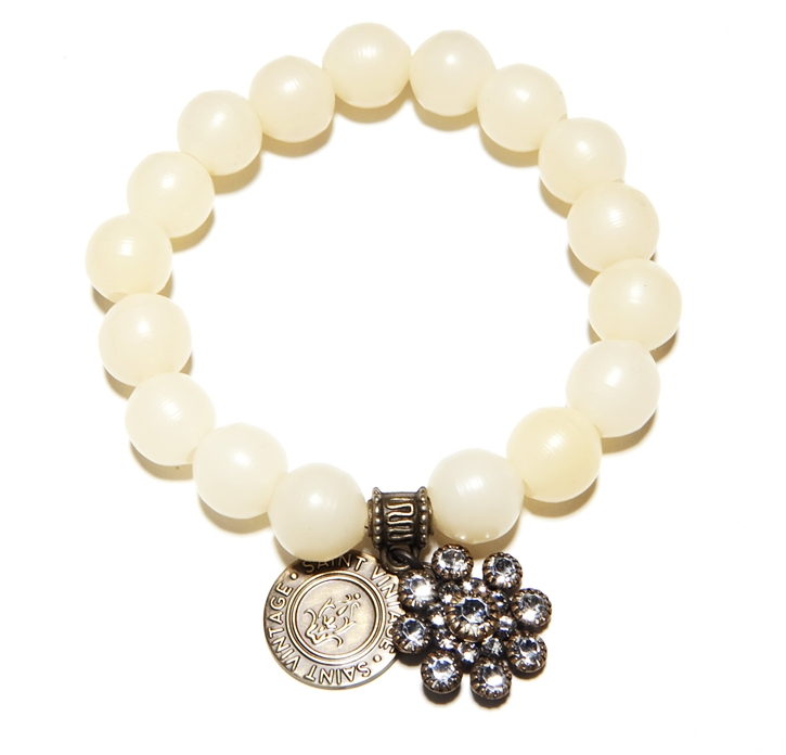 Ivory colored Vintage Beads create this classic Love Cures Stretch Bracelet accented with our Swarovski Snowflake Crystal Charm.