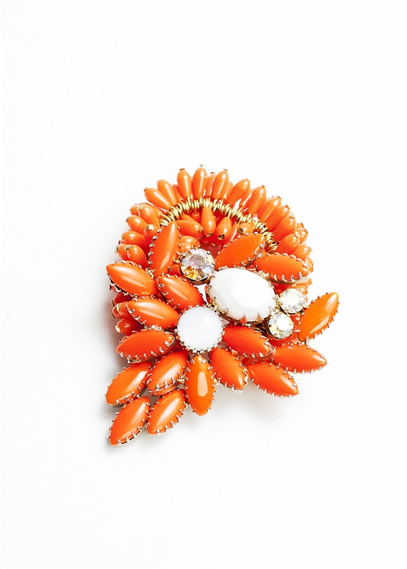 Antique brooch with orange, white and crystal stones created into a one of a kind stretch bracelet using vintage orange teardrop beads. A truly stunning piece of arm candy from our Wear a Braclet, Find a Cure Campaign.
