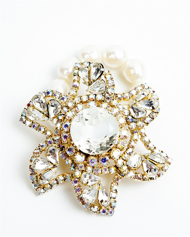 An one of a kind antique crystal floral brooch is used with pearls to create a truly stunning piece of jewelry from our Wear a Bracelet, Find a Cure Campaign.