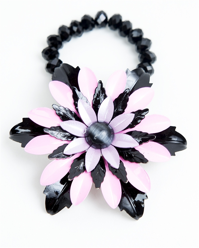 Antique pink and black brooch created into a one of a kind stretch bracelet using vintage beads. A truly stunning piece of arm candy from our Wear a Braclet, Find a Cure Campaign.