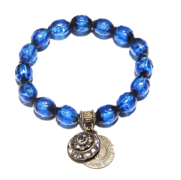 Antique Czech Blue Glass Beads, pre-WWII with Swarovski vintage Crystal Charm bring life to our Love Cures stretch bracelet.