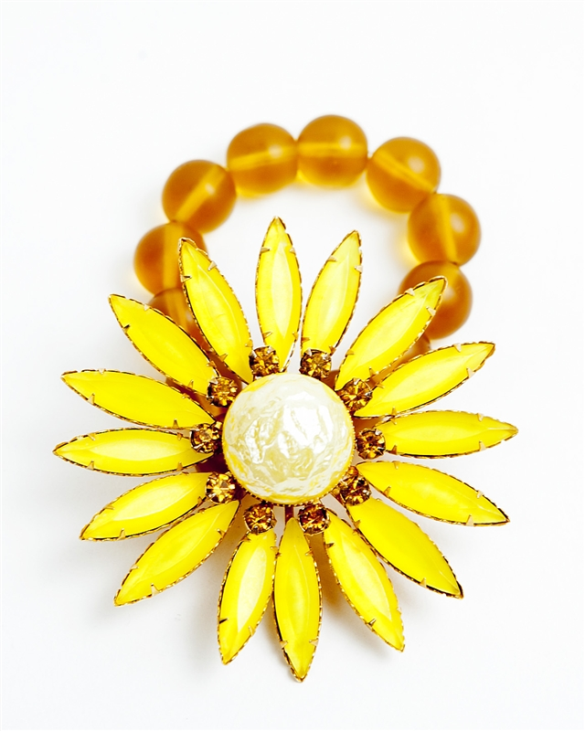 Antique yellow Daisy brooch with yellow enamel, topaz crystal stones and a pearl center which was created into a one of a kind stretch bracelet using vintage orange teardrop beads. A truly stunning piece of arm candy from our Wear a Braclet, Find a Cure C