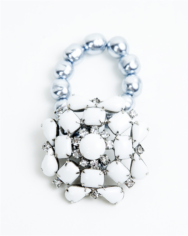 Antique white crystal brooch created into a one of a kind stretch bracelet using vintage grey pearls. A truly stunning piece of arm candy from our Wear a Braclet, Find a Cure Campaign.