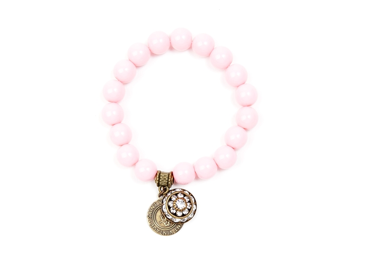 Baby Pink Vintage Beads create this classic Love Cures Stretch Bracelet accented with our Swarovski Corinne Crystal Charm. Support BCA.