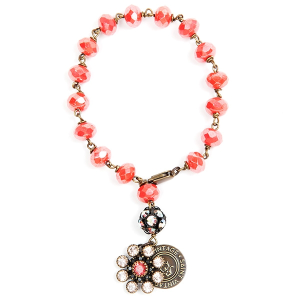 "Beautiful coral czech beads with an iridescent finish are featured in this pretty bracelet perfect for any season. 7""in length."