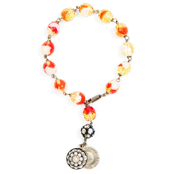 "Beautiful orange and yellow Czech beads that bring to mind sunshine are featured in this pretty bracelet perfect for any season. 7""in length."