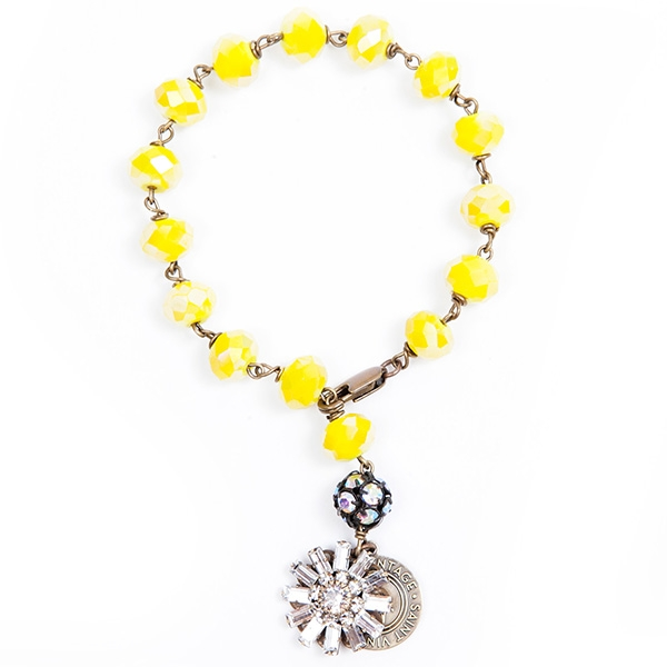 "Our pretty sunny yellow Czech beaded bracelet with a clear crystal charm that sparkles during an season. 7""in length."