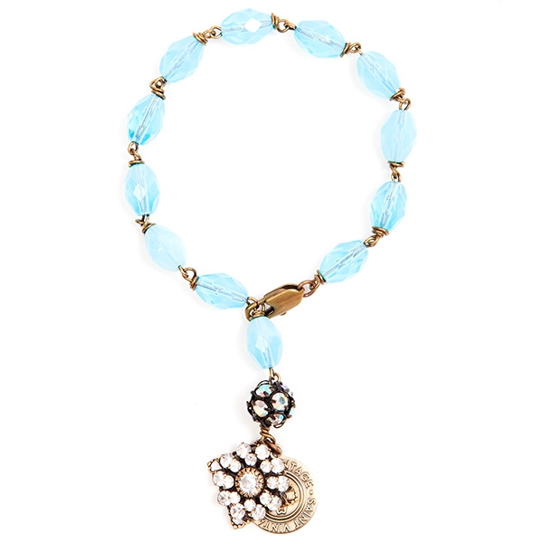 "Beautiful aquamarine czech glass beads are featured in this pretty beaded bracelet with a sweet clear crystal charm. 7""in length."