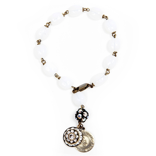 "We have created this white Czech glass beaded bracelet in support of Lung Cancer Awareness month.  Only available for the month of November.  Bracelet is approximately 7"" in length. 50% of sales will be donated back to Stand Up 2 Cancer! #jewelryforacause"