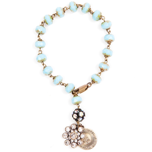 "Beautiful turquoise beads are combined with a petite clear crystal charm. 7""in length."