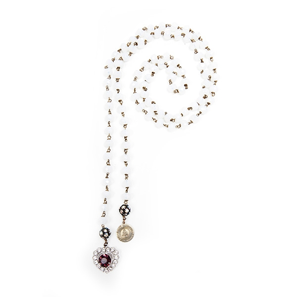 A beautiful amethyst and clear crystal heart charm is featured on this white Czech glass beaded lariat and our signature SV tag. 39.5""