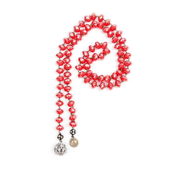 Coral Czech glass beads with an iridescent finish are combined with a pretty antique crystal charm and our signature SV tag. 39.5""