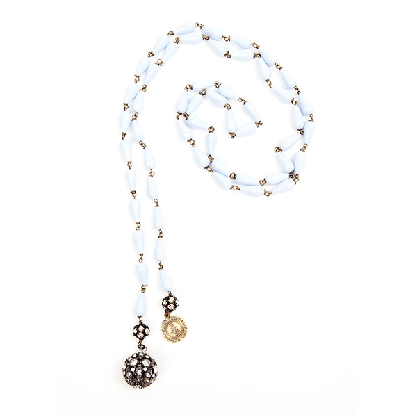 Baby blue Czech glass beads are combined with a antique crystal charm and our signature SV tag. 39.5""