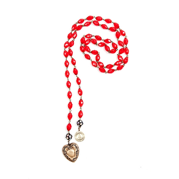 Red Czech glass beads are combined with a lovely reclaimed brass heart charm and our signature SV tag. 39.5""