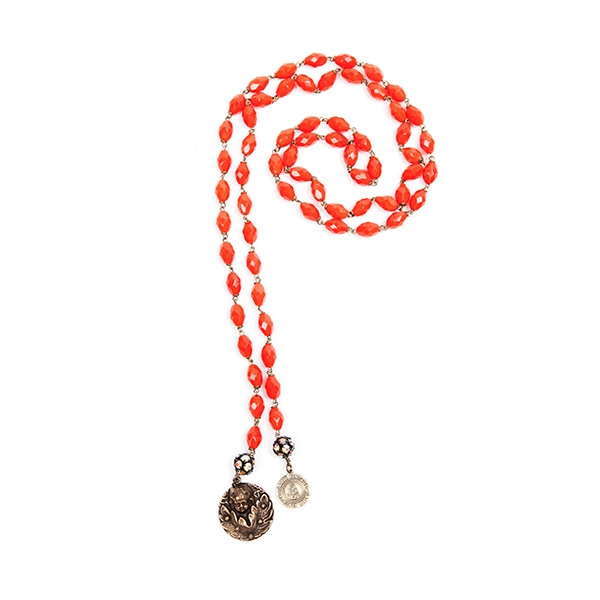 Red Czech glass beads are combined with a reclaimed brass angel charm and our signature SV tag. 39.5""