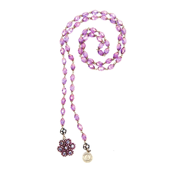 Purple Czech glass beads are combined with a lovely purple crystal floral charm and our signature SV tag. 39.5""