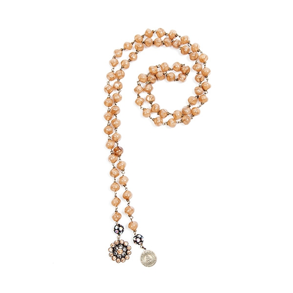 Our peachy Czech beads are combined with a pretty crystal flower charm that matches perfectly.  Signature SV tag. 39.5""