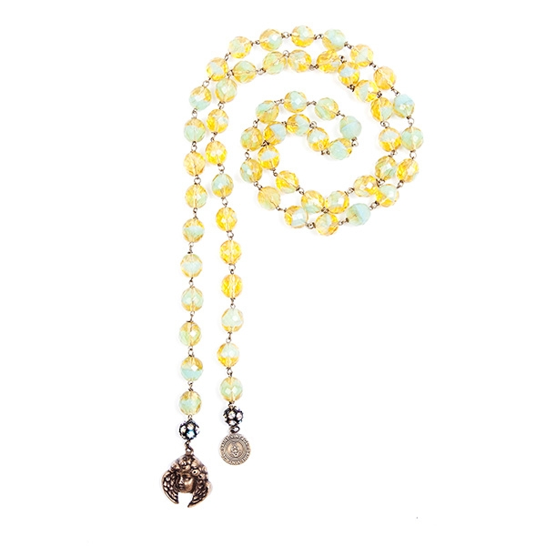Yellow and mint green Czech glass beads are combined with a lovely angel charm and our signature SV tag. 39.5""
