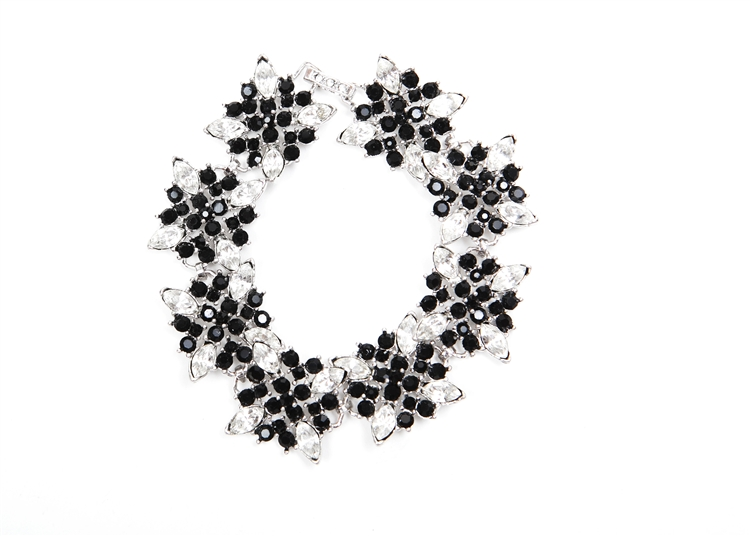 "The striking contrast of clear and black crystal are used to update our antique inspred statement bracelet.  7"" in length.  Perfect for any occasion!"