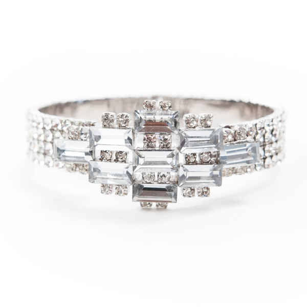 This vintage inspired crystal cuff bracelet adds the perfect amount sparkle for any occasion.  This cuff was styled after pieces from designer, Paige Jansen-Nichols personal antique collection.
