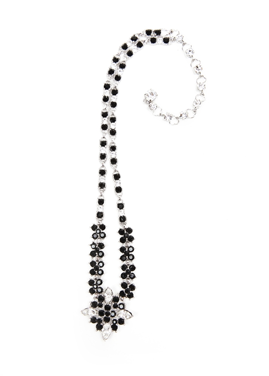 "The striking contrast of clear and black crystal are used to update our antique inspired statement necklace. 18"" necklace with 2"" extender.  Perfect for any occasion."