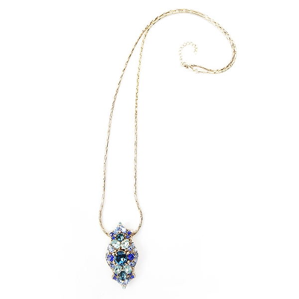 "Our clip necklace with crystals in shades of blue and an antique brass finish.  This necklace can be worn on a chain, on a handbag or as a scarf clip.  The clip pendant comes with 30"" chain with 2"" extender. #jewelryforacause #findacure"