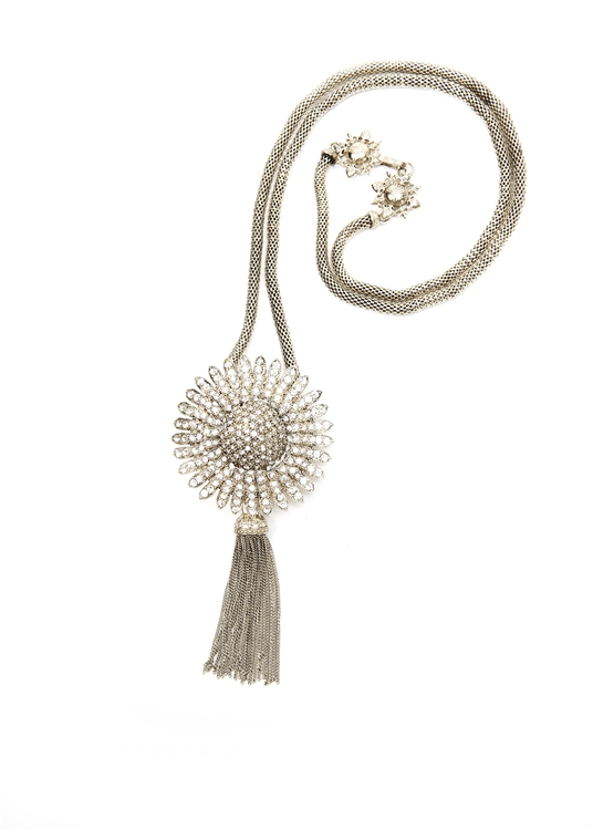 "This necklace is a burst of sunshine with clear crystals set into brass with an antique finish.  32""in length. Tassel and chain are removable. #jewelryforacause"